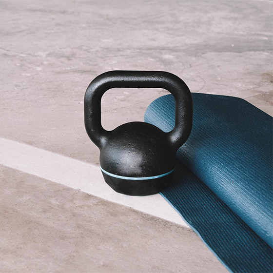 kettlebell and yoga mat on gym floor